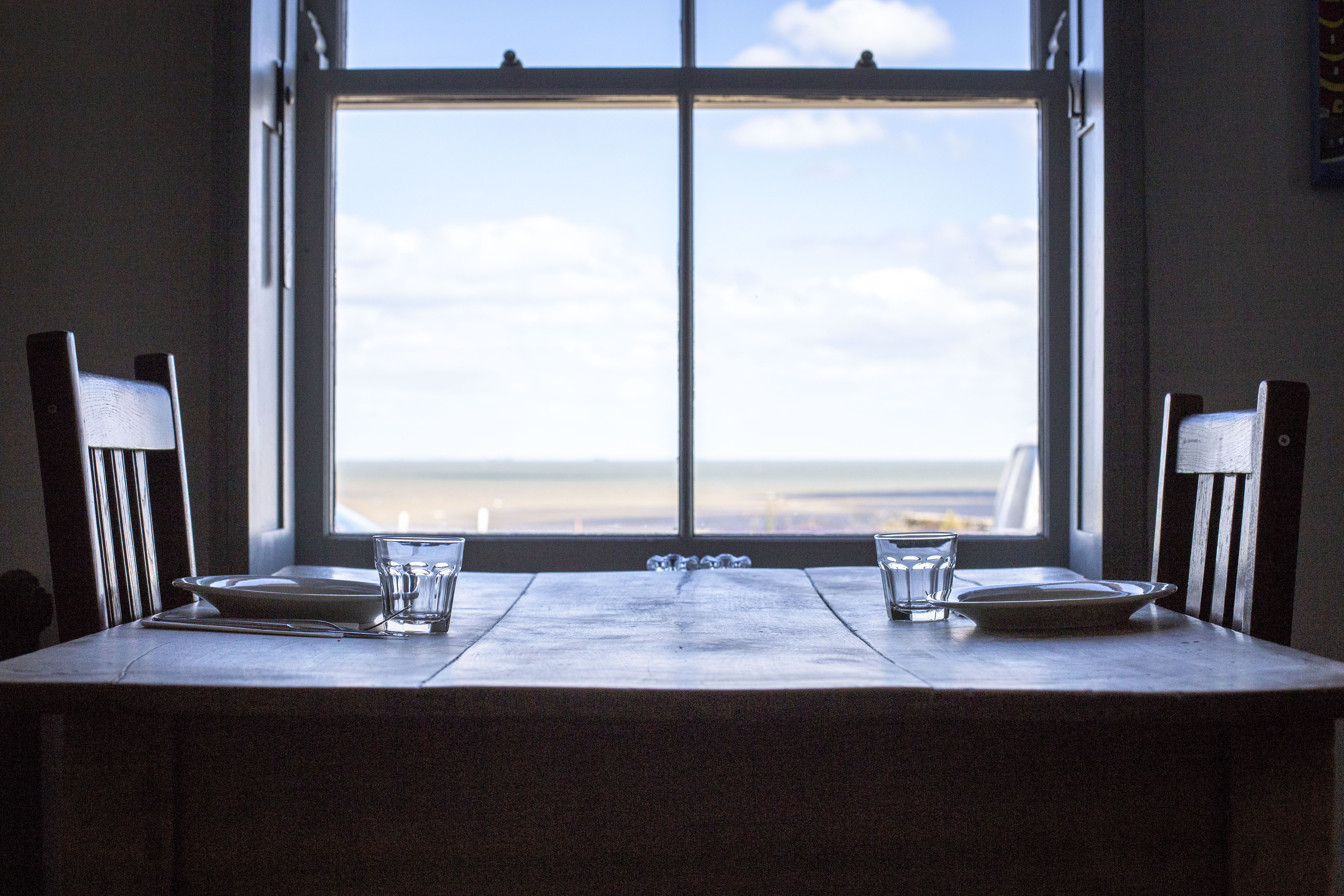 table by the window sea views dining restaurant interiors